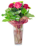 Red roses flowers in a floral arrangement, bouquet, transparent vase close up, isolated Royalty Free Stock Photography