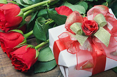 Red roses and gift box for birthday, valentine Royalty Free Stock Photo