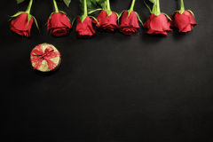 Red roses and gift box with copy space Royalty Free Stock Photo