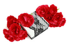Red roses on a gift box, decorated with lace ribbon Stock Photography