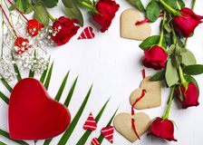 Red roses, gift box and heart shapes cookies on white background. Valentines day background with copy space Stock Photos