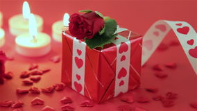 Red roses and gift box on red background stock video footage