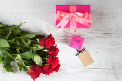 Red roses and gift boxes top view Stock Photo