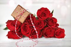 Red roses with a gift stock photo