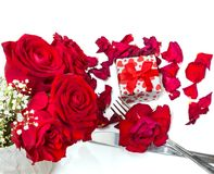 Red roses, gift and silverware - Valentines Day menu Stock Photos
