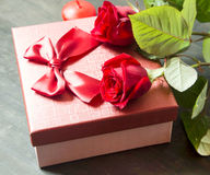 Red Roses and Gift for Valentine's Day Stock Image