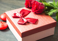 Red Roses and Gift for Valentine's Day Royalty Free Stock Photography