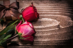 Red roses giftbox on wooden board holidays concept Royalty Free Stock Photo