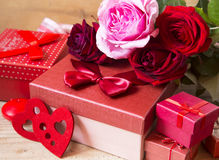 Red Roses and Gifts for Valentine's Day Stock Image