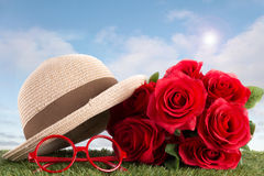 Red roses and glasses on green grass Royalty Free Stock Photos
