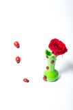 Red roses in a green vase Stock Image