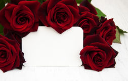 Red roses and greeting card Stock Photos