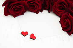 Red roses and greeting card Royalty Free Stock Photos