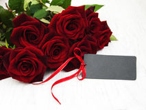 Red roses and greeting card Stock Images