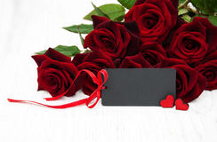 Red roses and greeting card Royalty Free Stock Image