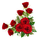 Red roses and gypsophila flowerswith leaves in a corner arrangement