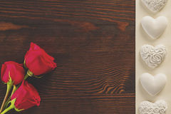 Red roses and gypsum hearts Royalty Free Stock Images