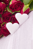 Red roses with heart decoration Royalty Free Stock Photo