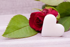 Red roses with heart decoration Stock Photo