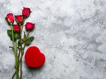 Red roses and heart shape box stock photos
