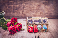 Red roses and heart-shape chocolate for Valentine's Day. Retro s Royalty Free Stock Images
