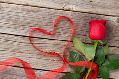Red roses and heart shape ribbon over wood Royalty Free Stock Photos