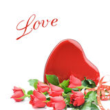 Red roses with heart shaped box of chocolate Stock Images