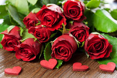 Red roses. And heart on wooden table Stock Photo