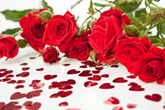 Red roses and hearts. Red roses bouquet and hearts on white background stock photos