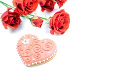 Red roses with hearts for Valentine isolated on a white backgrou Royalty Free Stock Photography