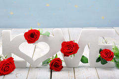 Red roses and love inscription on Valentines Day with space for. Text Stock Photo