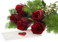 Red roses with love letter. Symbol for valentines day, mothers Day, wedding or birthday Stock Photos