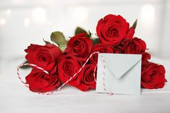 Red roses with love letter. On a white background with tender bokeh for valentines day Royalty Free Stock Images