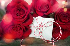 Red roses with love letter. In shabby chic style and bokeh for valentines day Royalty Free Stock Photo