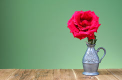 Red roses in a metal vase Stock Photography