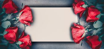 Red roses mock up banner on gray desktop background, top view. Layout for Valentines day, dating and love greeting card. Anniversary and invitations. Retro Stock Photo