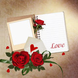Red roses, notepad, frame on vintage background Stock Image