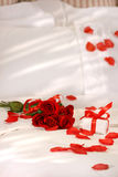 Red Roses On A Bed Royalty Free Stock Images