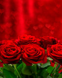 Red roses over valentines day background with hearts Royalty Free Stock Image