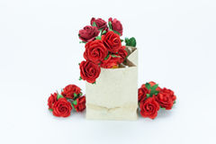 Red roses in paper bag on white  background Stock Photo