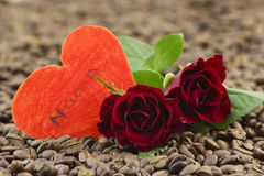 Red roses and paper hearts Stock Photos