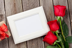 Red roses, photo frame and gift box Royalty Free Stock Photography