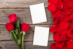 Red roses, photo frames and petals Stock Photo