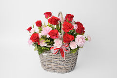 Red roses and pink carnations Stock Images