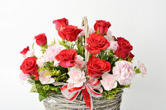 Red roses and pink carnations Royalty Free Stock Photos