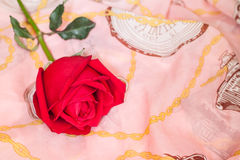 Red roses on pink cloth Royalty Free Stock Photo
