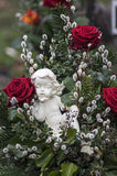 Red roses and porcelain angel Stock Images