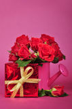 Red roses and red gift box Stock Photos