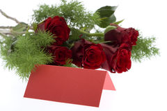 Red roses with a red place card Stock Image