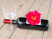 Red roses and red wine Stock Photo